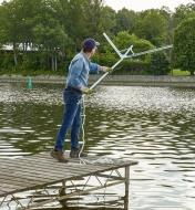 A man at the end of a dock holding a Weed Razer Pro