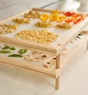 Closer view of the leg connecting two trays at the corner of the Pasta and Herb Drying Rack