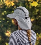 Back view of a woman wearing a light gray adventure sun hat