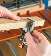 Setting the Kerfmaker to the thickness of a board in preparation for cutting a dado