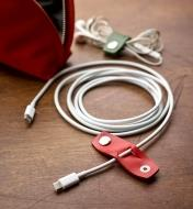 Electronics cord with an open Leather Cord Keeper attached to it