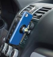 Dashboard-mount kit installed on a car dashboard with a cell phone attached
