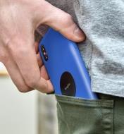 Slipping a cell phone with a steel disc attached to its case into a pants pocket