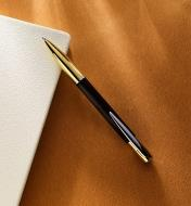 Example of a Yari gold pen turned from a wood blank