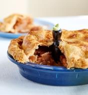 Baked pie sliced to show Pie Bird inside