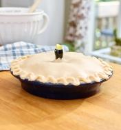 Unbaked pie with the head of the Pie Bird in the center