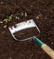 Close-up of the Dutch Hoe head weeding in a garden
