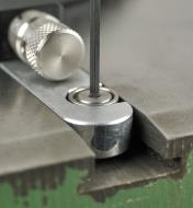 Tightening the bar snugger screws in the guide bar of the JessEm Mite-R-Excel II Miter Gauge