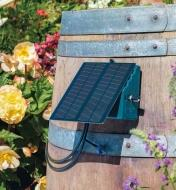 Solar panel mounted to the side of a barrel
