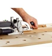 Using the Domino joiner horizontally to cut holes for Domino tenons in a panel door frame to join rails and stiles