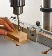 """A Veritas 1 1/2"""" flip stop mounted in the T-track on the drill-press table's fence"""