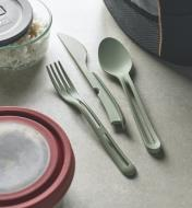 Klikk utensils set out on a table, ready to use