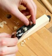 The miniature bevel-up jack plane is used to trim a small piece of wood