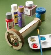 Paint and glitter ready for decorating the assembled ever-changeable kaleidoscope