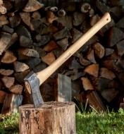Splitting axe embedded in a chopping block