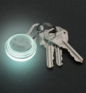 White Carabiner Light attached to a set of keys