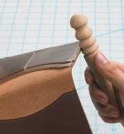 Sealing the edge of a leather folder with the Leather Slicker