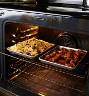 Two quarter sheet baking pans side by side on rack in oven.