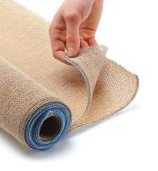 One end of the shade fabric roll is turned back to show the knitted fabric and stitched edges