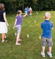 A family playing Koob in a park