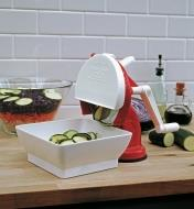 Hand-Crank Slicer & Grater slicing zucchini