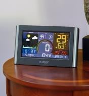 The display unit of the Wi-Fi weather station with wind sits on a tabletop