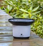 Rain sensor of the Wi-Fi weather station with wind and rain collects rainfall in its funnel