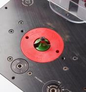 A JessEm insert ring in place on a router table