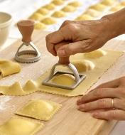 Cutting out ravioli shapes in the kitchen