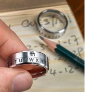 A secret decoder ring being used to encrypt a secret message