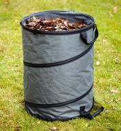 Hard-bottom pop-up tote filled with yard waste