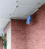 Drying rack in raised position close to a ceiling
