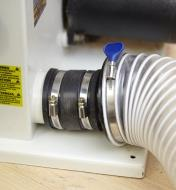 """The 2 1/2"""" I.D. flexible coupler connecting a dust port to a dust collection hose"""