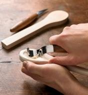 Hollowing the bown of a wooden spoon with the hook knife