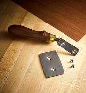 The double-edged blade of a Pax veneer saw shown separated from the handle so it can be reversed