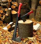 The hatchet set in the end of a piece of unsplit firewood, with the splitting axe leaning next to it