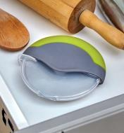 Blade guard in place on the pizza cutter for storing it in a kitchen drawer