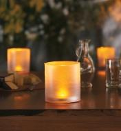 Three Inflatable Solar Candle Lanterns on an outdoor table