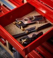 Cork and nitrile-rubber grip liner used to pad the bottom of a metal tool drawer