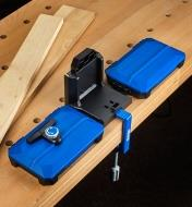 The Kreg docking station secured to a workbench with the included table clamp for greater stability
