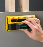 Franklin M210 stud detector used to locate two wooden studs through a drywall sheet