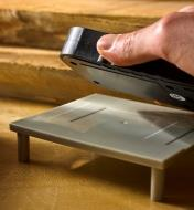 Seating the Wagner Orion 930 dual depth moisture meter on the recessed area of the calibrator