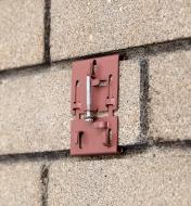 Brick clamp attached to brickwork that has recessed mortar