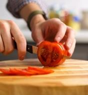 Slicing a tomato with the serrated paring knife