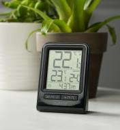 The compact wireless thermometer display shows temperatures, relative humidity and time of day