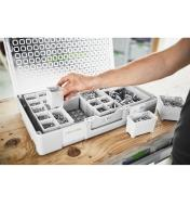 A small box of hardware is inserted into an open space in the organizer.