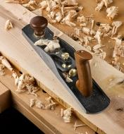 Veritas Low-Angle Jack Plane sitting on a board surrounded by wood shavings