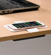A calibration template guides phone placement on the surface above the wireless charger