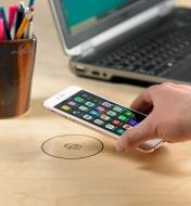 Placing a phone on a sticker marking the surface charging location of the wireless charger