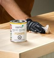 Applying Osmo Polyx gloss hard wax oil to a wood surface